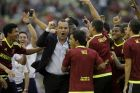 Venezuela's coach Rafael Dudamel, center, celebrates with his players during a welcome home ceremony at University Stadium in Caracas, Venezuela, Tuesday, June 13, 2017. Venezuela finished second at the FIFA U-20 World Cup Korea 2017, played in in South Korea. (AP Photo/Fernando Llano)