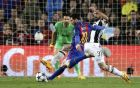Barcelona's Lionel Messi attemptts a shot at goal past Juventus' Giorgio Chiellini, right, during the Champions League quarterfinal second leg soccer match between Barcelona and Juventus at Camp Nou stadium in Barcelona, Spain, Wednesday, April 19, 2017. (AP Photo/Emilio Morenatti)