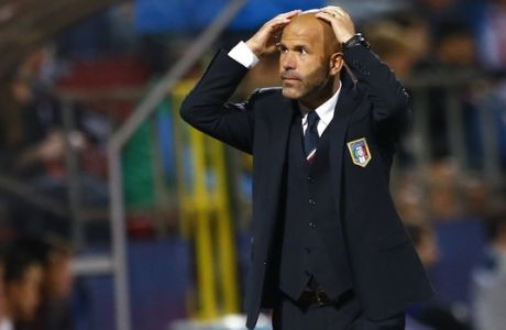 Italy's coach Luigi Di Biagio gestures during the Euro U21 soccer championship group B match between England and Italy, at the Ander stadium in Olomouc, Czech Republic, Wednesday, June 24, 2015. (AP Photo/Matthias Schrader)