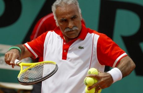 Iran's Mansour Bahrami serves the ball to USA's John McEnroe and Ecuador's Andres Gomez during a men's legends match for the French Open tennis tournament at the Roland Garros stadium in Paris, Sunday, June 6, 2010. (AP Photo/Christophe Ena)