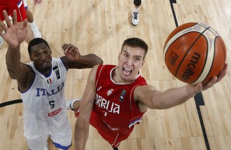 Serbia's Bogdan Bogdanovic, right, shoots past Italy's Paul Biligha, left, during their Eurobasket European Basketball Championship quarterfinal match in Istanbul, Wednesday, Sept. 13. 2017. (AP Photo/Thanassis Stavrakis)