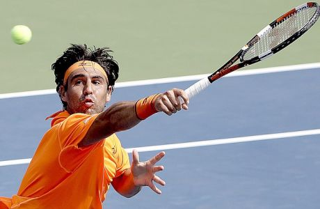 Marcos Baghdatis, of Cyprus, returns a shot to Ryan Harrison, of the United States, during the third round of the U.S. Open tennis tournament, Friday, Sept. 2, 2016, in New York. (AP Photo/Seth Wenig)