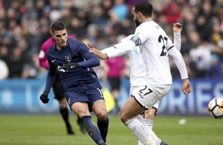 Tottenham Hotspur's Erik Lamela scores his side's second goal of the game against Swansea City during the English FA Cup, quarterfinal soccer match at the Liberty Stadium, Swansea, Wales, Saturday March 17, 2018. (Nick Potts/PA via AP)