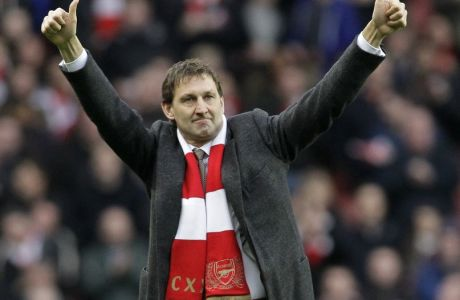 Former Arsenal's player Tony Adams reacts as he is being presented to the fans before the start of English Premier League soccer match between Arsenal and Queens Park Rangers at Emirates Stadium, London, Saturday, Dec. 31, 2011. (AP Photo/Sang Tan)