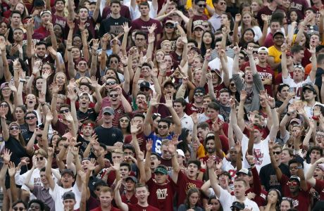Boston College fans during the first half of an NCAA college football game against Virginia Tech in Boston, Saturday, Aug. 31, 2019. (AP Photo/Michael Dwyer)