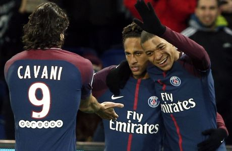 PSG's Neymar, right, celebrates with teammate Edinson Cavani, left, and Kylian Mbappe, right, during his French League One soccer match between Paris-Saint-Germain and Dijon, at the Parc des Princes stadium in Paris, France, Wednesday, Jan.17, 2018. (AP Photo/Thibault Camus)