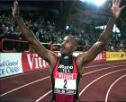 Frankie Fredericks of Namibia raises his arms after he broke the world record in the indoor 200-meter race at the Lievin International track meet, northern France, Sunday February 18, 1996. Fredericks broke the world record by running the distance in 19.92 seconds.(AP Photo/Michel Spingler)