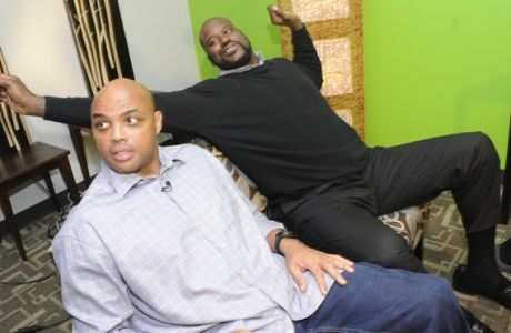 "Charles Barkley, left, and Shaquille O'Neal wrap up an interview at TNT studios after O'Neal joined the cast of the network's ""Inside the NBA"" for a live media call-in show on Thursday, Dec. 15, 2011, in Atlanta. O'Neal will be make his televised debut as a new host for the show during the upcoming Christmas Day NBA basketball game. (AP Photo/John Amis)"