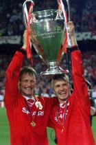 FILE - In this May 26, 1999, file photo, Manchester United's Teddy Sheringham, left, and David Beckham celebrate with the trophy after defeating Bayern Munich 2-1 to win the UEFA Champions League soccer final in Barcelona. Sheringham's goal in the 91st minute and Ole Gunnar Solksjaer's in the 93rd caused Manchester United's comeback to be considered one of the all-time greatest in sports history. (AP Photo/Camay Sungu, File)