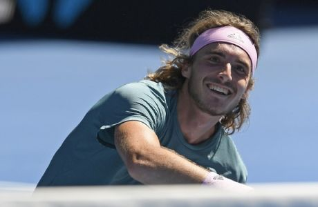 Greece's Stefanos Tsitsipas celebrates after defeating Spain's Roberto Bautista Agut in their quarterfinal match at the Australian Open tennis championships in Melbourne, Australia, Tuesday, Jan. 22, 2019. (AP Photo/Andy Brownbill)