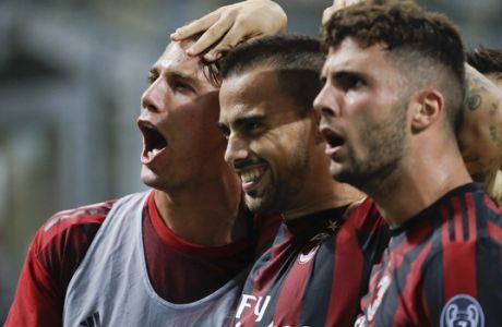 AC Milan's Suso, center, celebrates with his teammates Patrick Cutron, right, and Manuel Locatelli after scoring, during a Serie A soccer match between AC Milan and Cagliari, at the San Siro stadium in Milan, Italy, Sunday, Aug. 27, 2017. (AP Photo/Luca Bruno)