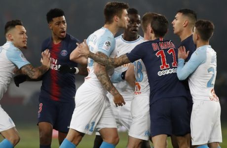 Marseille players, in white, and PSG players argue during their French League One soccer match between Paris-Saint-Germain and Olympique Marseille at the Parc des Princes stadium in Paris, Sunday, March 17, 2019. (AP Photo/Christophe Ena)