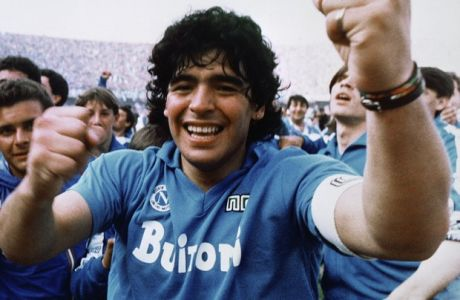 Argentine soccer superstar Diego Armando Maradona cheers after the Napoli team clinches its first Italian major league title in Naples on May 10, 1987. (AP Photo/Meazza Sambucetti)