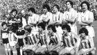 Η ομάδα της Ρεάλ Σοθιεδάδ στο τελευταίο ματς της σεζόν 1980/81, όταν κατέκτησε το πρώτο της πρωτάθλημα. Πίσω από αριστερά, Αρκονάδα, Άνθα (μασέρ), Θελαγιέτα, Κορταμπαρία, Αλόνσο, Γκόριθ, Ολαϊθόλα. Μπροστά από αριστερά, Ιντίγορας, Ντιέγο, Σατρούστεγκι, Θαμόρα, Λόπεθ Ουφάρτε.