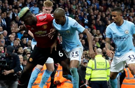 Manchester United's Paul Pogba vies for the ball with Manchester City's Kevin De Bruyne, Fernandinho and Gabriel Jesus, from left to right, during the English Premier League soccer match between Manchester City and Manchester United at the Etihad Stadium in Manchester, England, Saturday April 7, 2018. (AP Photo/Matt Dunham)
