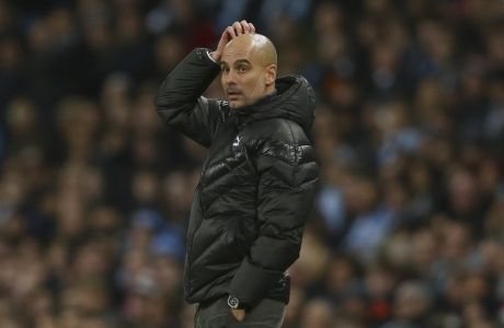 Manchester City's head coach Pep Guardiola watches his team during the group C Champions League soccer match between Manchester City and Shakhtar Donetsk at the Etihad Stadium in Manchester, England, Tuesday, Nov. 26, 2019. (AP Photo/Dave Thompson)