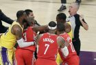 Houston Rockets' Chris Paul, second from left, fights with Los Angeles Lakers' Rajon Rondo, top right, during the second half of an NBA basketball game Saturday, Oct. 20, 2018, in Los Angeles. (AP Photo/Marcio Jose Sanchez)