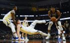 Milwaukee Bucks' Giannis Antetokounmpo is called for a charge on Golden State Warriors' Jonas Jerebko during the second half of an NBA basketball game Friday, Dec. 7, 2018, in Milwaukee. The Warriors won 105-95. (AP Photo/Morry Gash)