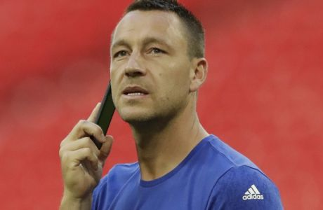 Chelsea's John Terry speaks on the phone walking alone on the pitch after his team lost the English FA Cup final soccer match between Arsenal and Chelsea at the Wembley stadium in London, Saturday, May 27, 2017. (AP Photo/Matt Dunham)