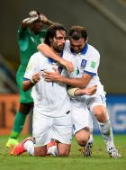 FORTALEZA, BRAZIL - JUNE 24:  Giorgos Samaras and Vasilis Torosidis of Greece celebrate as they are awarded a penalty during the 2014 FIFA World Cup Brazil Group C match between Greece and Cote D'Ivoire at Estadio Castelao on June 24, 2014 in Fortaleza, Brazil.  (Photo by Lars Baron - FIFA/FIFA via Getty Images)