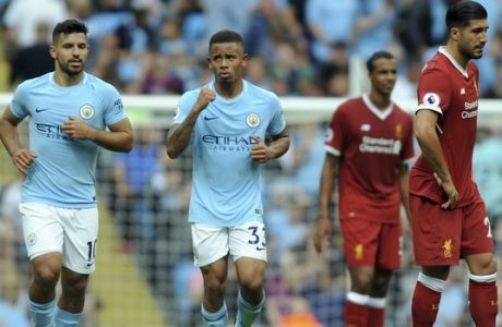 Manchester City's Gabriel Jesus, center, celebrates after scoring his side's 2nd goal during the English Premier League soccer match between Manchester City and Liverpool at the Etihad Stadium in Manchester, England, Saturday, Sept. 9, 2017. (AP Photo/Rui Vieira)