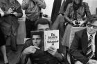 "Muhammad Ali peers over a copy of his book ""The Greatest,"" in the VIP room at the airport in Frankfurt, Oct. 10, 1975.  Ali came to Frankfurt to introduce his book at the International Book Fair.  (AP Photo/Kurt Strumpf)"
