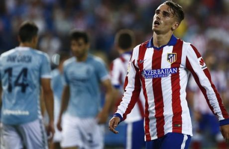 Atletico's Antoine Griezmann, right,  gestures during a Spanish La Liga soccer match between Atletico de Madrid and Eibar at the Vicente Calderon stadium in Madrid, Spain, Saturday, Aug. 30, 2014. (AP Photo/Andres Kudacki)