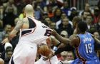 Oklahoma City Thunder's Serge Ibaka, rear right, of the Republic of Congo, pulls on the jersey of Atlanta Hawks' Pero Antic, of Macedonia, while reaching for the ball during the fourth quarter of an NBA basketball game, Friday, Jan. 23, 2015, in Atlanta. The Hawks won 103-93. (AP Photo/David Goldman)
