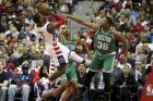 Washington Wizards guard John Wall (2) loses control as he tries to shoot past Boston Celtics guard Marcus Smart (36) during the first half of a second-round NBA playoff series basketball game, Thursday, May 4, 2017, in Washington. (AP Photo/Andrew Harnik)