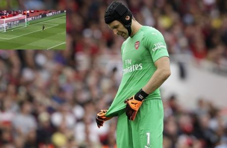 Arsenal goalkeeper Petr Cech reacts during the English Premier League soccer match between Arsenal and Manchester City at the Emirates stadium in London, England, Sunday, Aug. 12, 2018. (AP Photo/Tim Ireland)