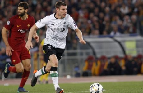 Liverpool's James Milner runs with the ball during the Champions League semifinal second leg soccer match between Roma and Liverpool at the Olympic Stadium in Rome, Wednesday, May 2, 2018. (AP Photo/Riccardo De Luca)