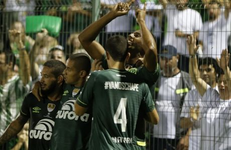 Luiz Otavio of Brazil's Chapecoense, right, celebrates with teammates after scoring against Colombia's Atletico Nacional, during a Recopa Sudamericana first leg final soccer match in Chapeco, Brazil, Tuesday, April 4, 2017. (AP Photo/Andre Penner)