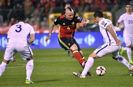 Belgium's Radja Nainggolan, center, is challenged by Greece's Sokratis Papatathopoulos, second right, during the Euro 2018 Group H qualifying match between Belgium and Greece at the King Baudouin stadium in Brussels on Saturday, March 25, 2017. (AP Photo/Geert Vanden Wijngaert)