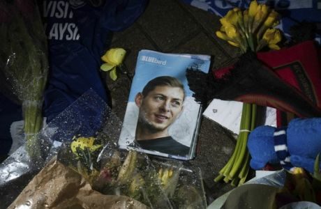 Tributes are placed outside the Cardiff City Stadium, Wales, for Emiliano Sala, Friday Feb. 8, 2019. Tributes are being paid across soccer to Argentine player Emiliano Sala, with the French league announcing a minute's applause before matches. French club Nantes says it will retire the No. 9 jersey worn by Sala before he was sold last month to Cardiff in the English Premier League. (Aaron Chown/PA via AP)