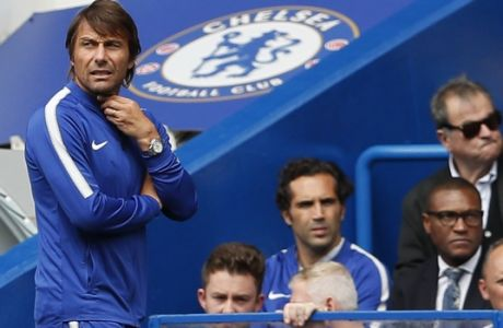 Chelsea's manager Antonio Conte, left, watches the match during the English Premier League soccer match between Chelsea and Burnley at Stamford Bridge stadium in London, Saturday, Aug. 12, 2017. (AP Photo/Kirsty Wigglesworth)