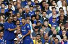 Chelsea's manager Maurizio Sarri, left, gives instructions to Eden Hazard during the English Premier League soccer match between Chelsea and Arsenal at Stamford bridge stadium in London, Saturday, Aug. 18, 2018. (AP Photo/Alastair Grant)