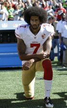 FILE - In this Sept. 25, 2016, file photo, San Francisco 49ers' Colin Kaepernick kneels during the national anthem before an NFL football game against the Seattle Seahawks, in Seattle. (AP Photo/Ted S. Warren,  File)