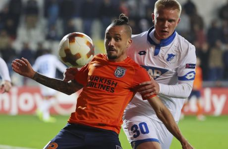 Basaksehir's Stefano Napoleoni, left, controls the ball in front of Hoffenheim's Phillipp Ochs, right, during the Europa League group C soccer match between Basaksehir and Hoffenheim, at the Fatih Terim stadium in Istanbul, Thursday, Nov. 2, 2017. (AP Photo)