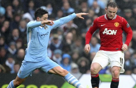 Manchester United's Wayne Rooney, right, vies for the ball with Manchester City's French player Samir Nasri, left, during their FA Cup third round soccer match at the Etihad stadium, Manchester, England, Sunday, Jan. 8, 2012. (AP Photo/Scott Heppell)