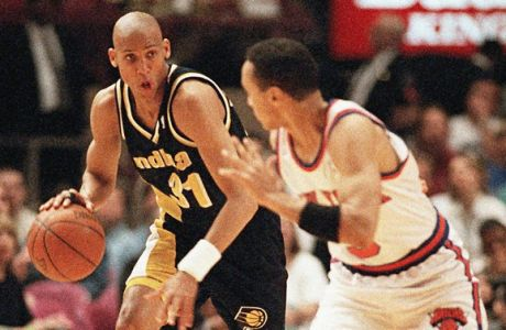 File - Indiana Pacers guard Reggie Miller, left, brings the ball down court while covered by New York Knicks guard John Starks during the first half of their NBA Eastern Conference Semifinals playoff game at New York's Madison Square Garden in this Sunday, May 7, 1995 file photo. Miller's eight points in the last eighteen seconds of the game brought the Pacers from behind to win 107-105. Following Manchester Citys fightback on Sunday to win the English Premier League, Miller's eight points  is another example  of famous sporting fightbacks - ranging from Citys biggest rivals Manchester United scoring twice in injury time to win the 1999 Champions League to Muhammad Alis rope-adope strategy he used to beat George Foreman in the Rumble in the Jungle (AP Photo/L.M. Otero, file)