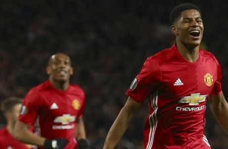 Manchester United's Marcus Rashford celebrates scoring his side's second goal during the Europa League quarterfinal second leg soccer match between Manchester United and Anderlecht at Old Trafford stadium, in Manchester, England, Thursday, April 20, 2017. (AP Photo/Dave Thompson)