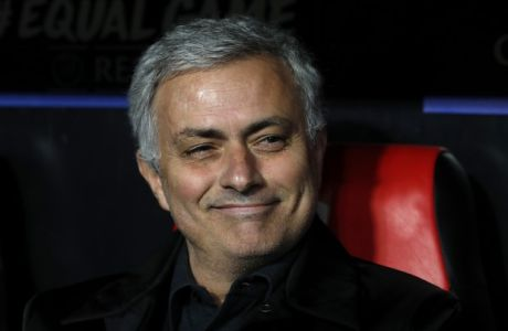 Manchester United manager Jose Mourinho smiles on the bench before the Champions League round of sixteen first leg soccer match between Sevilla FC and Manchester United at the Ramon Sanchez Pizjuan stadium in Seville, Spain, Wednesday, Feb. 21, 2018. (AP Photo/Miguel Morenatti)