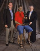 SAN ANTONIO - MAY 9:  Tim Duncan #2 of the San Antonio Spurs (C), President-CEO of Holt Companies Peter Holt (L), and NBA Commissioner David Stern (R), pose for a studio portrait with Tim's MVP Trophy in San Antonio, Texas on May 9, 2002.  NOTE TO USER: User expressly acknowledges and agrees that, by downloading and/or using this Photograph, User is consenting to the terms and conditions of the Getty Images License Agreement. (Photo by Andrew D Bernstein/Getty Images/NBAE)