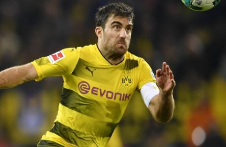 Dortmund's Sokratis, right, and Cologne's Jhon Cordoba Copete challenge for the ball during the German Bundesliga soccer match between Borussia Dortmund and 1.FC Cologne in Dortmund, Germany, Sunday, Sept. 17, 2017. (AP Photo/Martin Meissner)