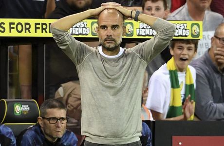 Manchester City manager Pep Guardiola looks dejected on the touchline during the English Premier League soccer match between Norwich City and Manchester City at Carrow Road, Norwich, England, Saturday, Sept. 14, 2019. (Joe Giddens/PA via AP)