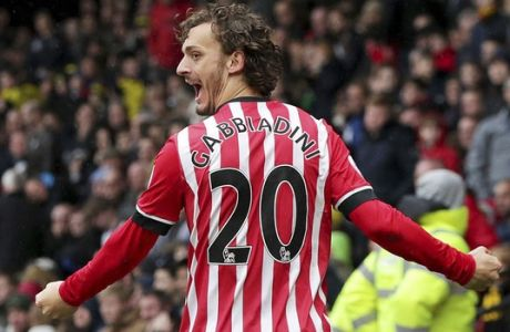 Southampton's Manolo Gabbiadini celebrates scoring his side's third goal, during the English Premier League soccer match between Watford and Southampton, at Vicarage Road, in Watford, England, Saturday, March 4, 2017. (Yui Mok/PA via AP)