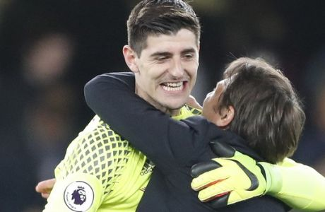 Chelsea's manager Antonio Conte hugs Chelsea's goalkeeper Thibaut Courtois at the end of the English Premier League soccer match between Chelsea and Middlesbrough at Stamford Bridge stadium in London, Monday, May 8, 2017. Chelsea won the match 3-0. (AP Photo/Frank Augstein)