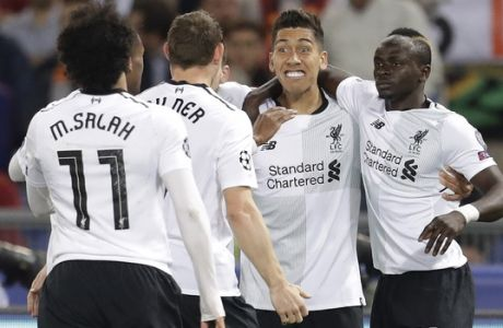 Liverpool's Sadio Mane, right, celebrates scoring his side's first goal with his team during the Champions League semifinal second leg soccer match between Roma and Liverpool at the Olympic Stadium in Rome, Wednesday, May 2, 2018. (AP Photo/Andrew Medichini)