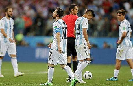 Argentina's Lionel Messi, front, walks along the pitch with teammates at the end of the group D match between Argentina and Croatia at the 2018 soccer World Cup in Nizhny Novgorod Stadium in Nizhny Novgorod, Russia, Thursday, June 21, 2018. Croatia defeated Argentina 3-0. (AP Photo/Ricardo Mazalan)