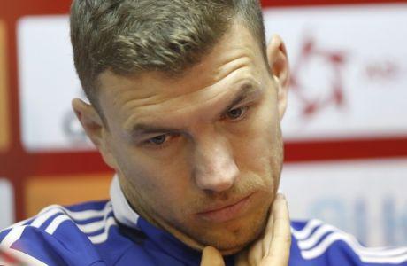Bosnian national team player Edin Dzeko reacts during press conference in Zenica, Bosnia, on Thursday, Nov. 12, 2015. Bosnia will play EURO 2016 playoff soccer match against Ireland Friday.(AP Photo/Amel Emric)